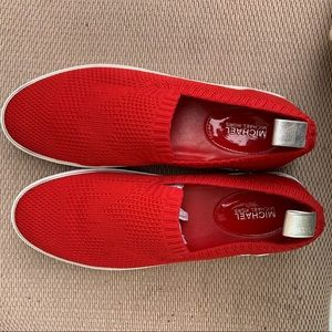 Red Michael Kors loafer tennis shoes.